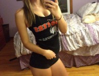 Cute babe rocking hooters gear
